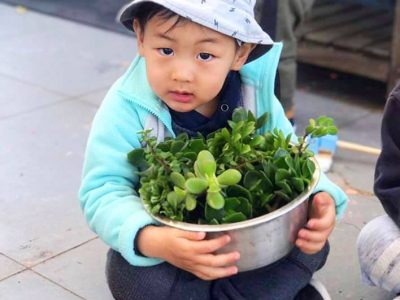 young-child-gardening